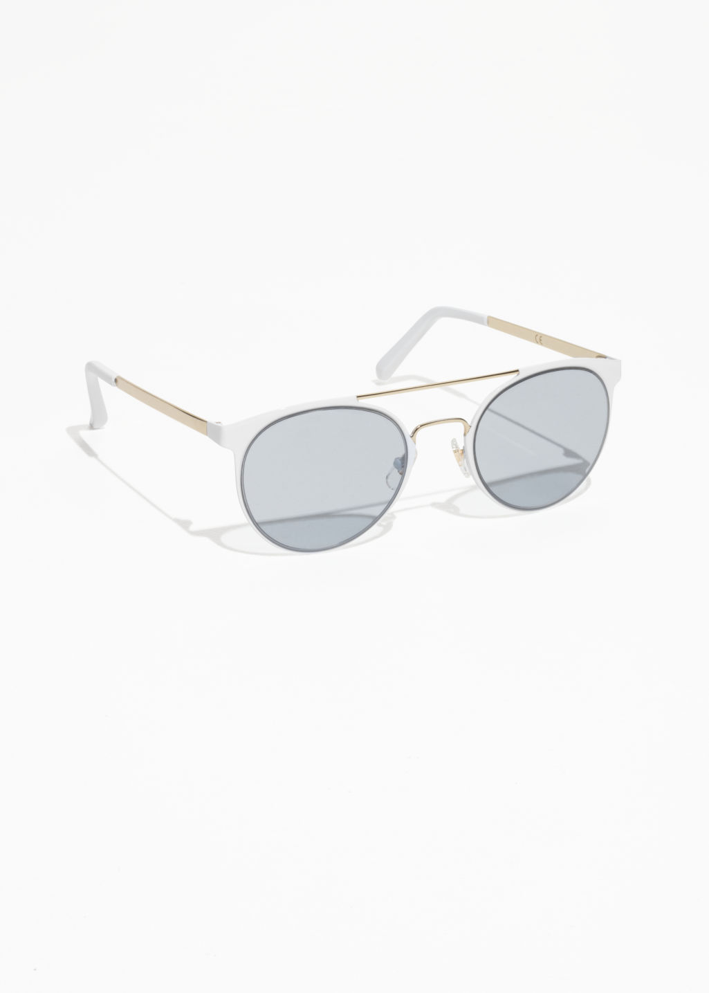 Front image of Stories metal frame shades in white