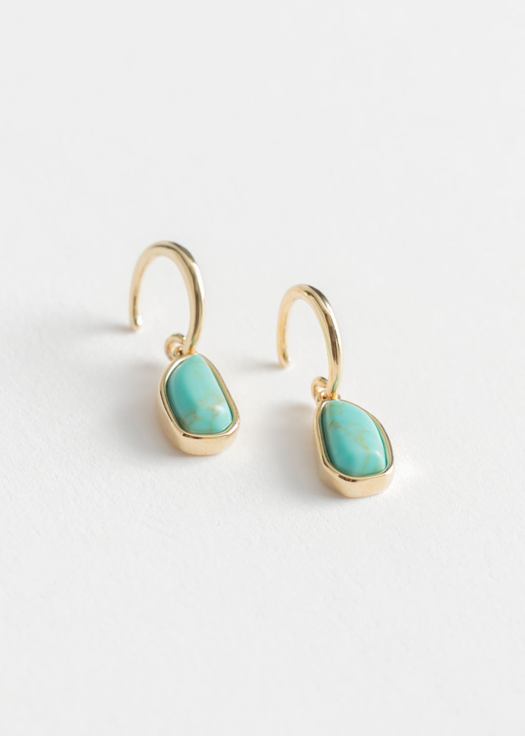 Front image of Stories hanging turquoise stone earrings in turquoise