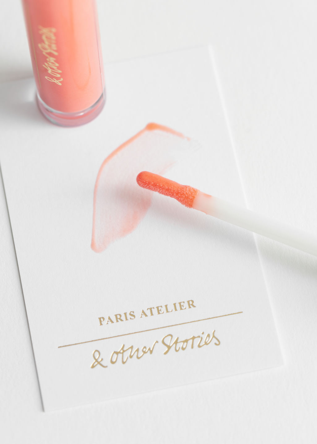 Back image of Stories lip gloss in orange