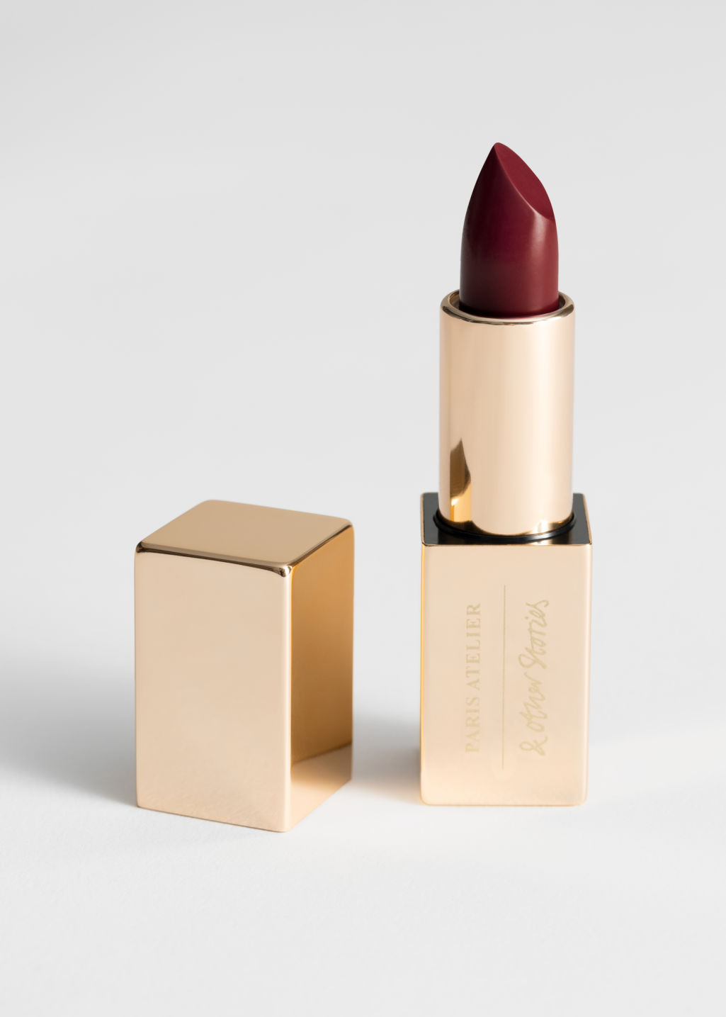 Front image of Stories lipstick in red