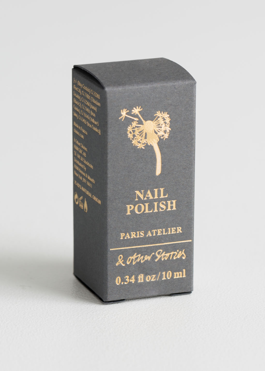 Back image of Stories nail polish in gold