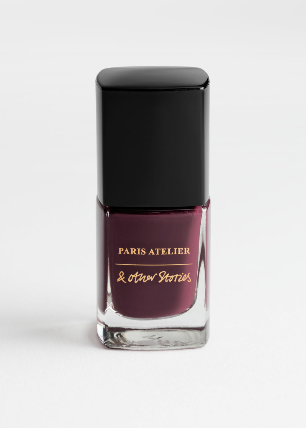 Front image of Stories nail polish in red