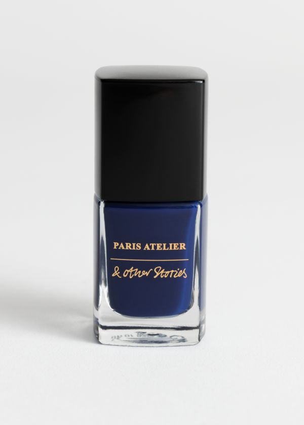 Front image of Stories nail polish in blue