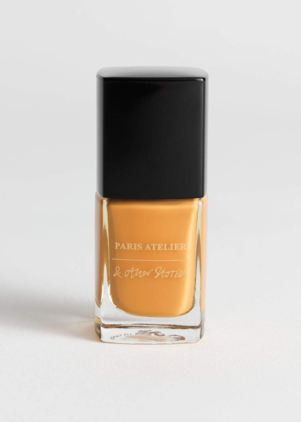 Front image of Stories nail polish in yellow