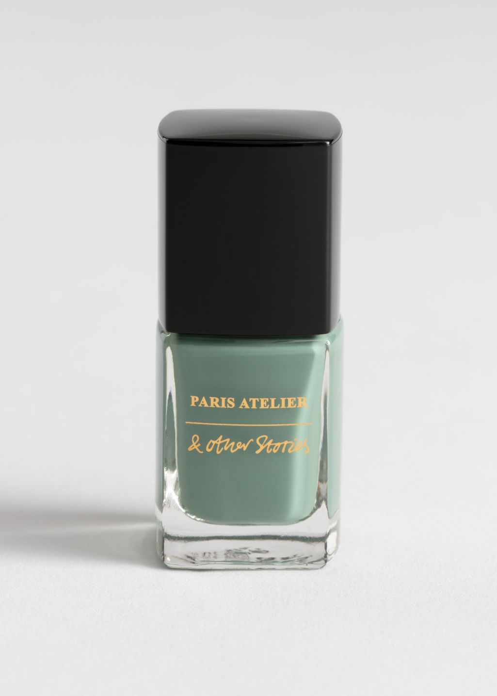 Front image of Stories nail polish in green