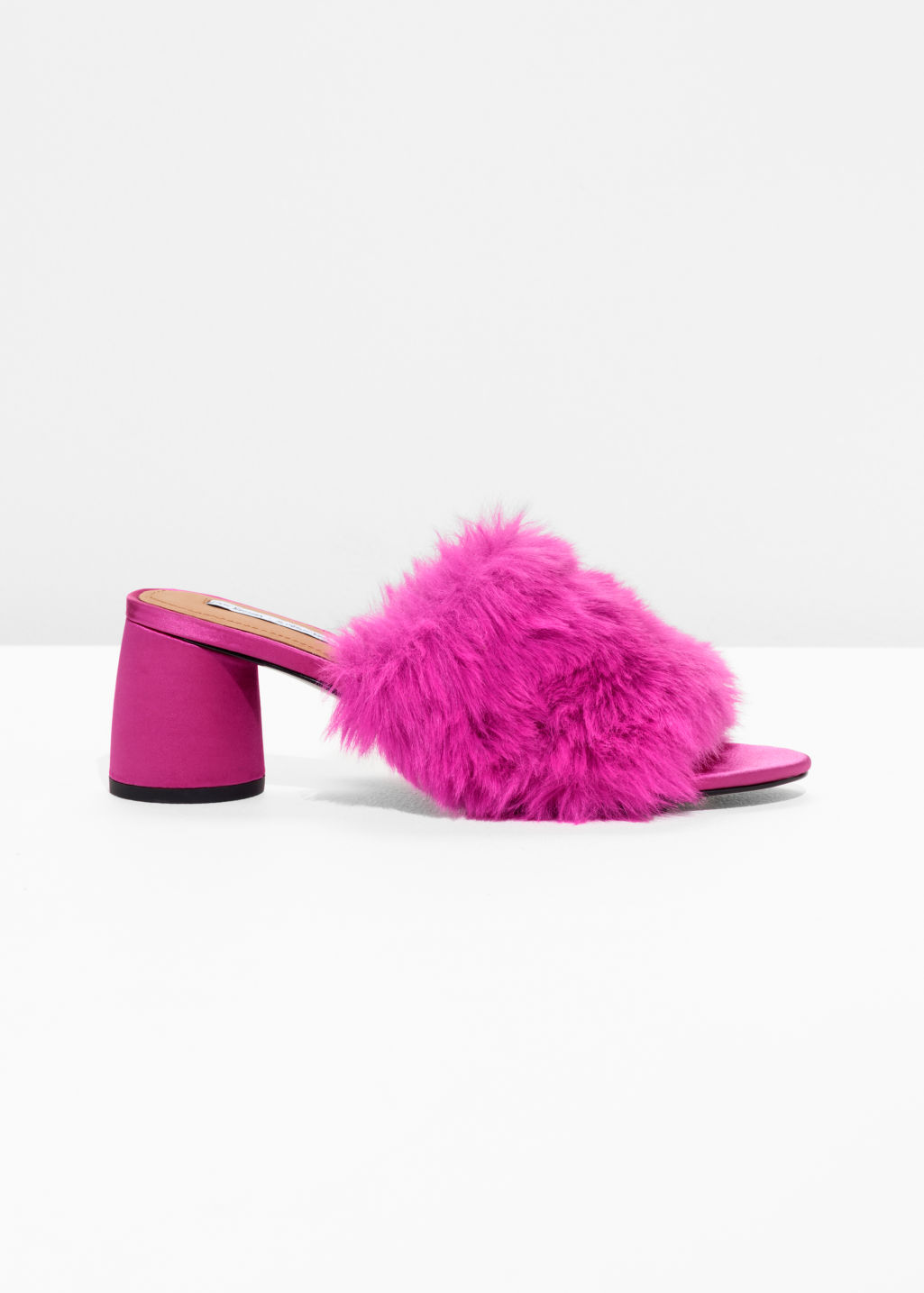 Front image of Stories faux fur mule sandalettes in pink