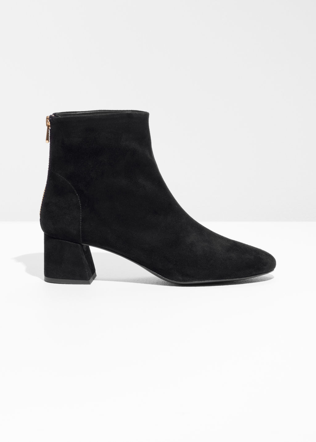Front image of Stories flare heel suede boots in black