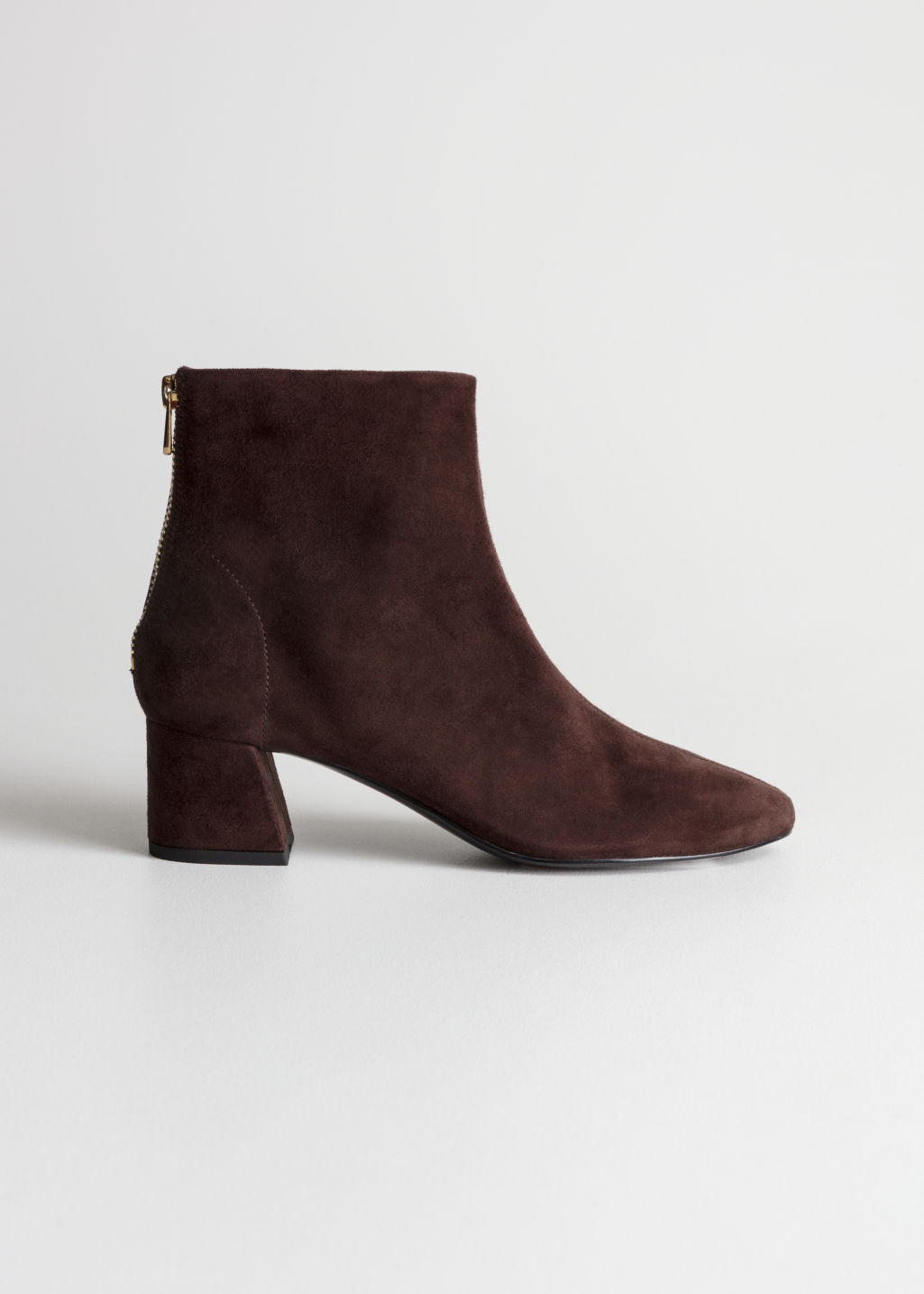 Front image of Stories flare heel suede boots in red