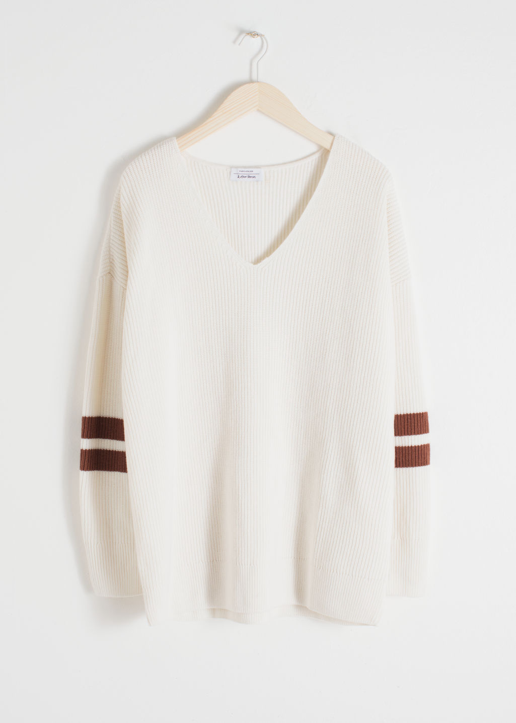 Front image of Stories stripe sleeve sweater in white