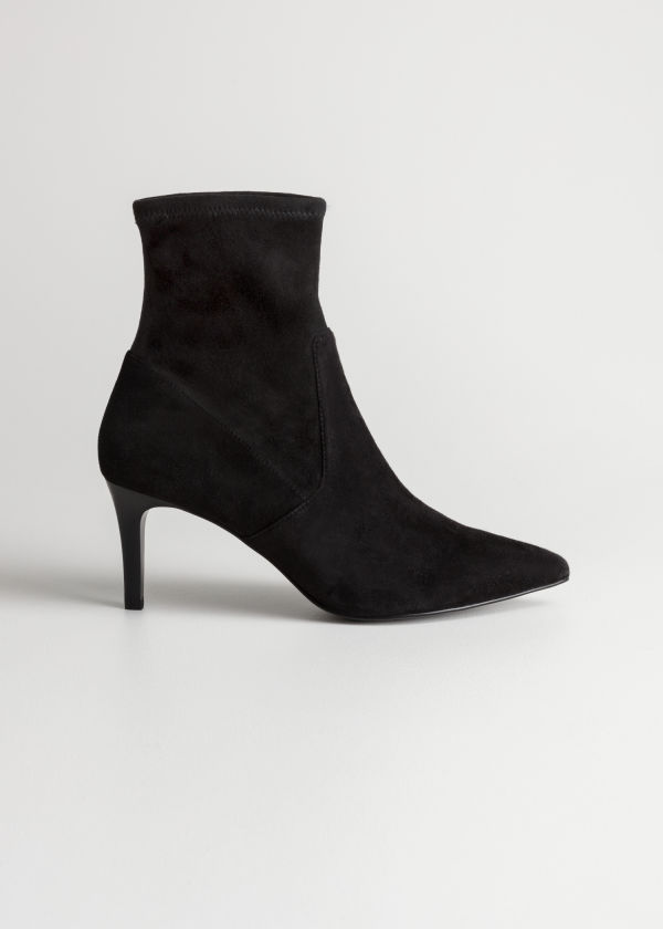 Front image of Stories stretch suede ankle boots in black