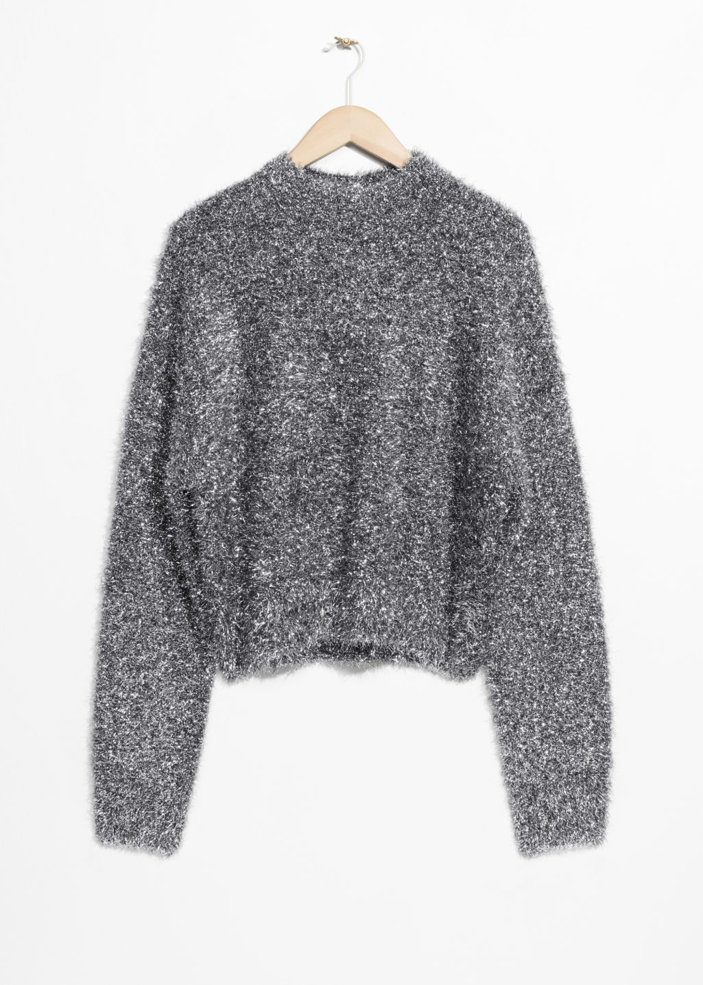 Front image of Stories metallic knit sweater in silver
