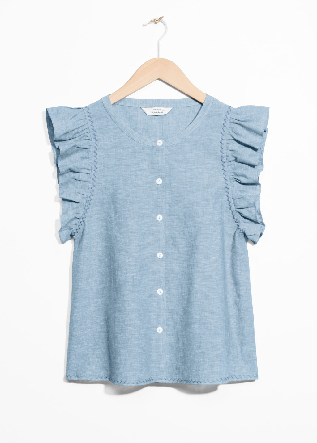 Front image of Stories cotton and linen blend frill top in blue