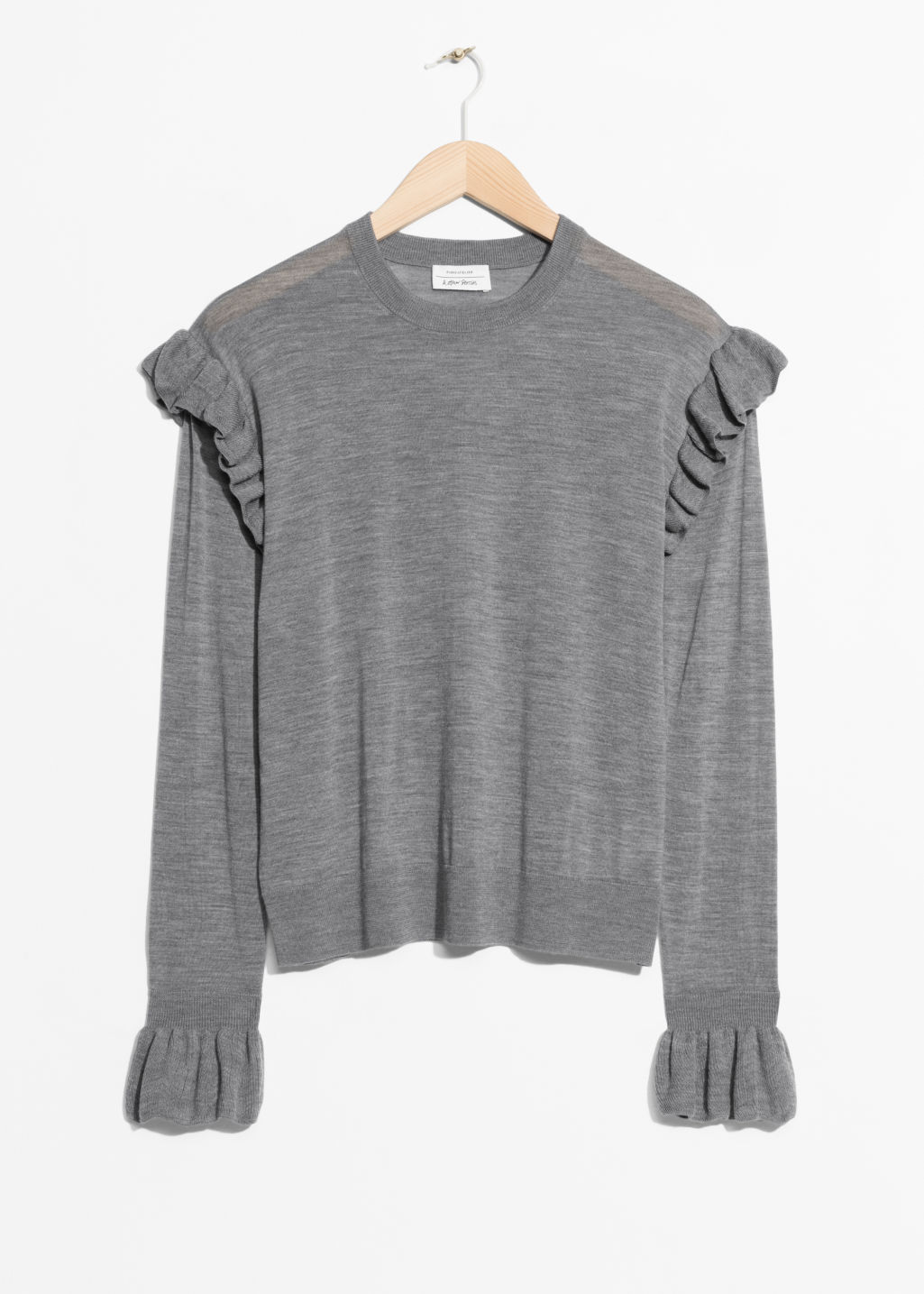 Front image of Stories frill merino wool sweater in grey