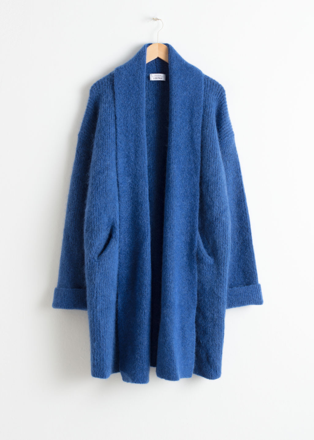 Front image of Stories rib knit cardigan in blue