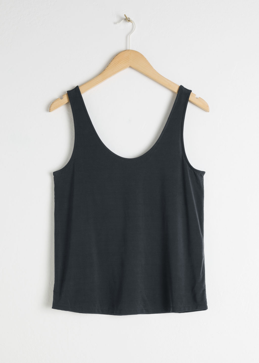 Front image of Stories cupro tank top in black