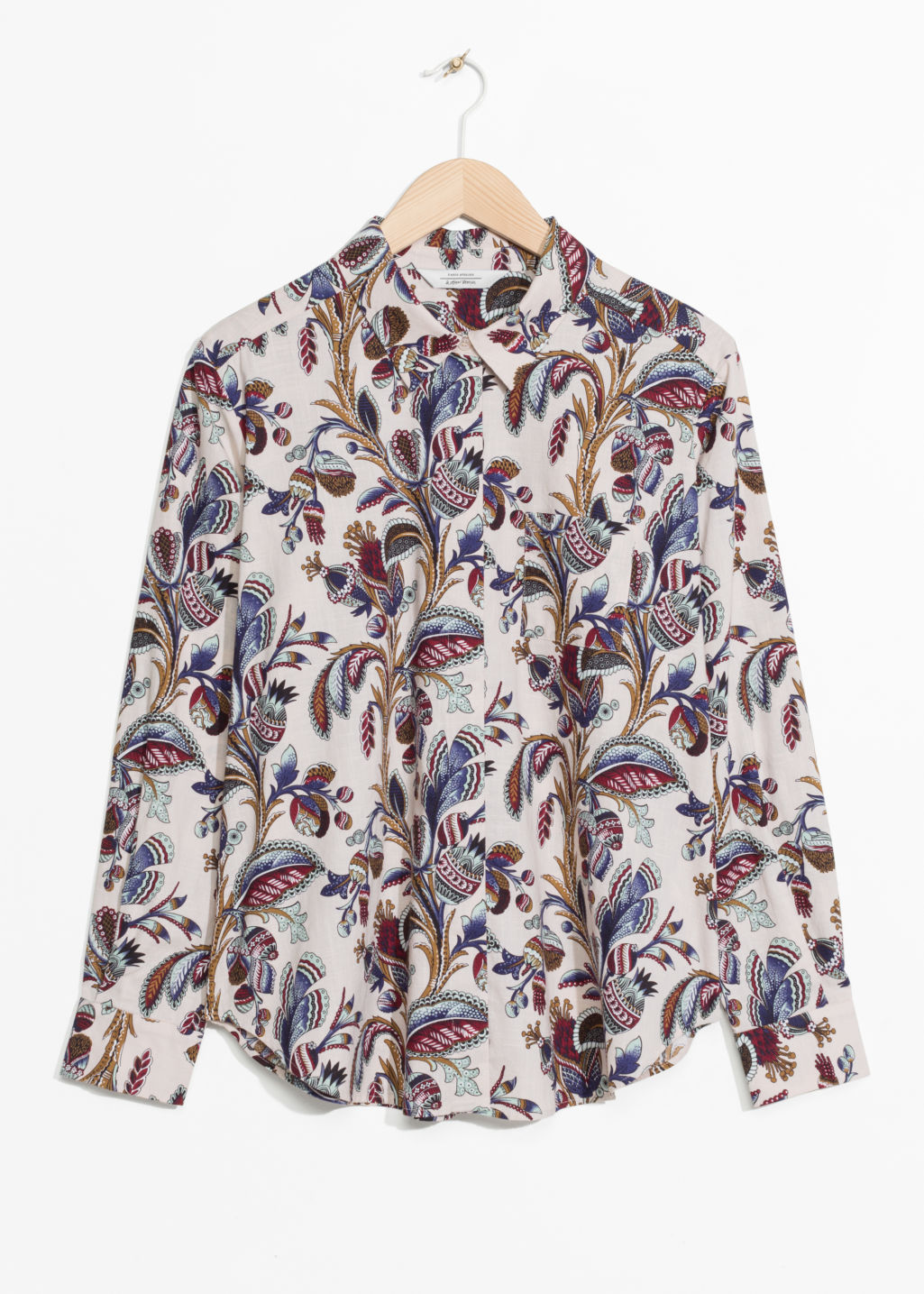 Front image of Stories climbing floral shirt in beige