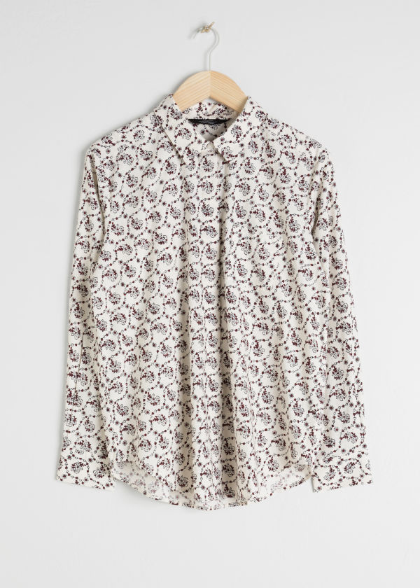 Front image of Stories climbing floral shirt in white