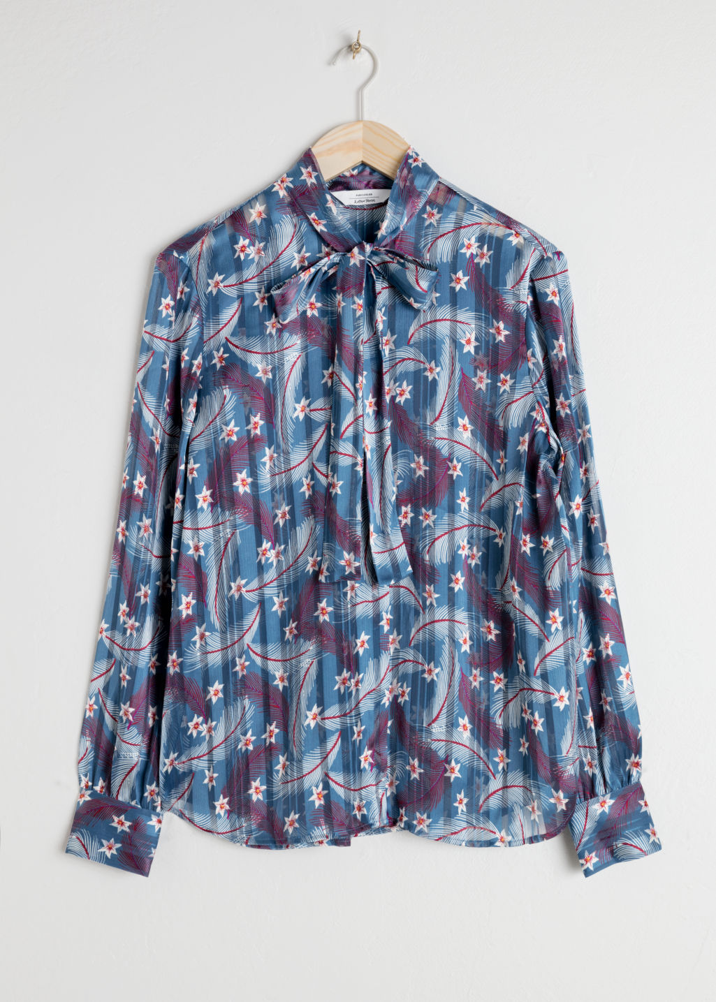 Front image of Stories printed pussy bow blouse in blue
