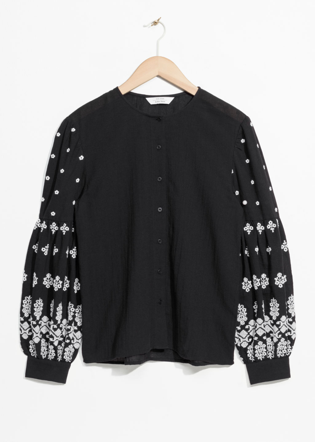 Front image of Stories embroidery puff sleeve blouse in black
