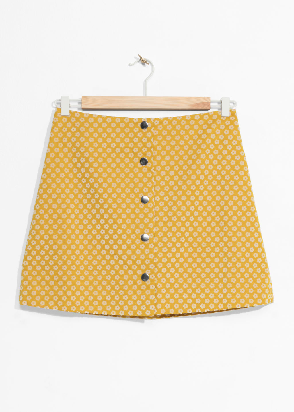 Front image of Stories mini skirt with button closure in yellow