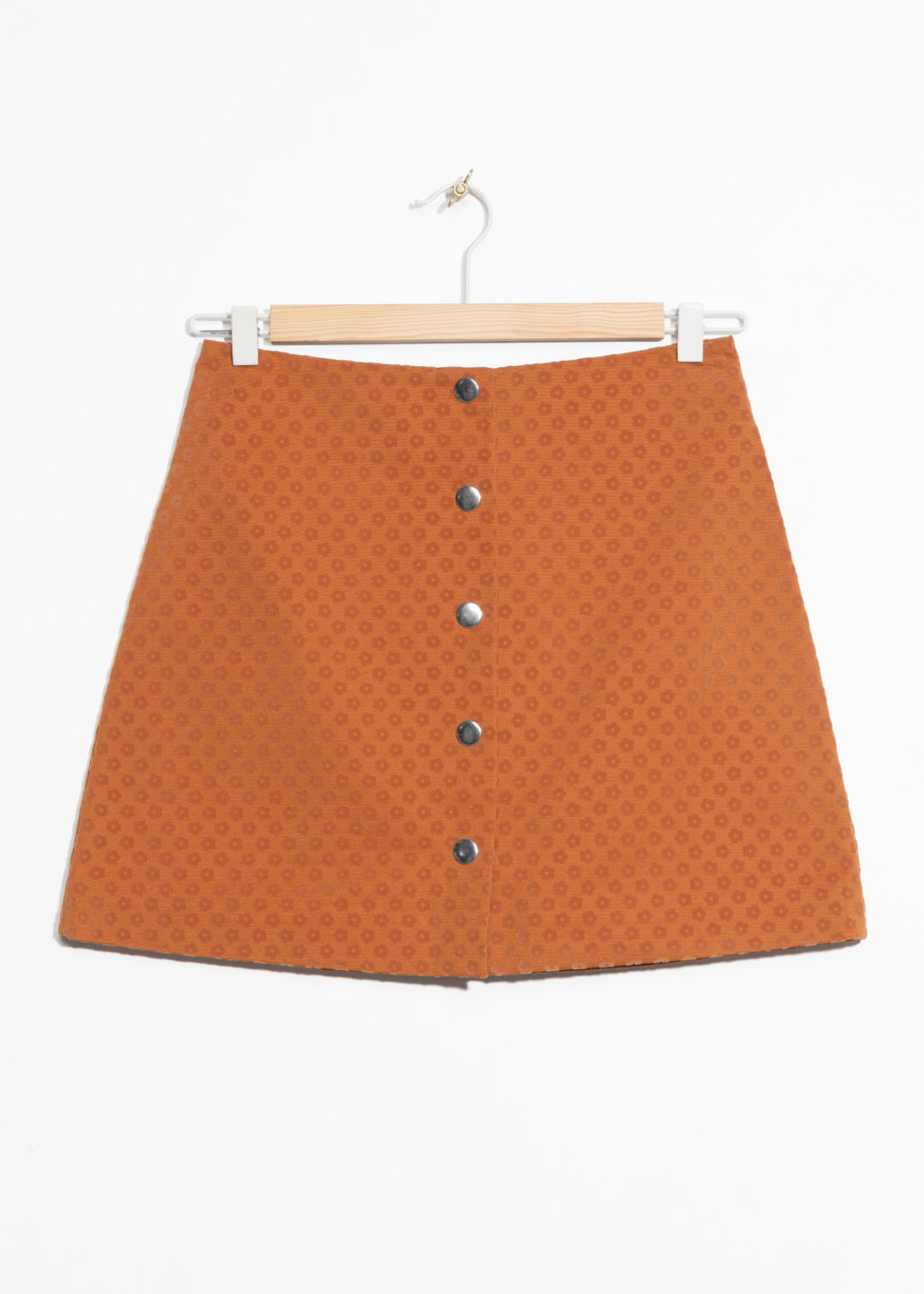 Front image of Stories mini skirt with button closure in orange