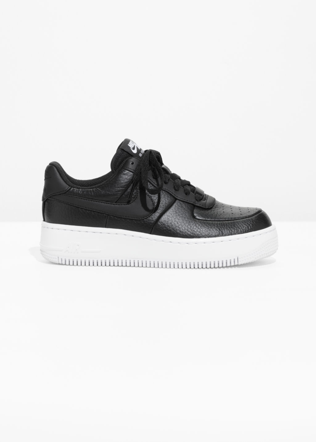 Front image of Stories n air force 1 upstep in black