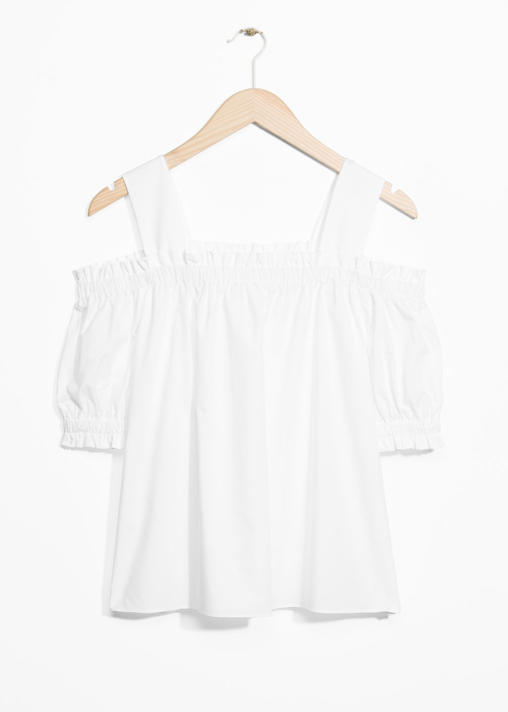 Front image of Stories cold-shoulder blouse in white