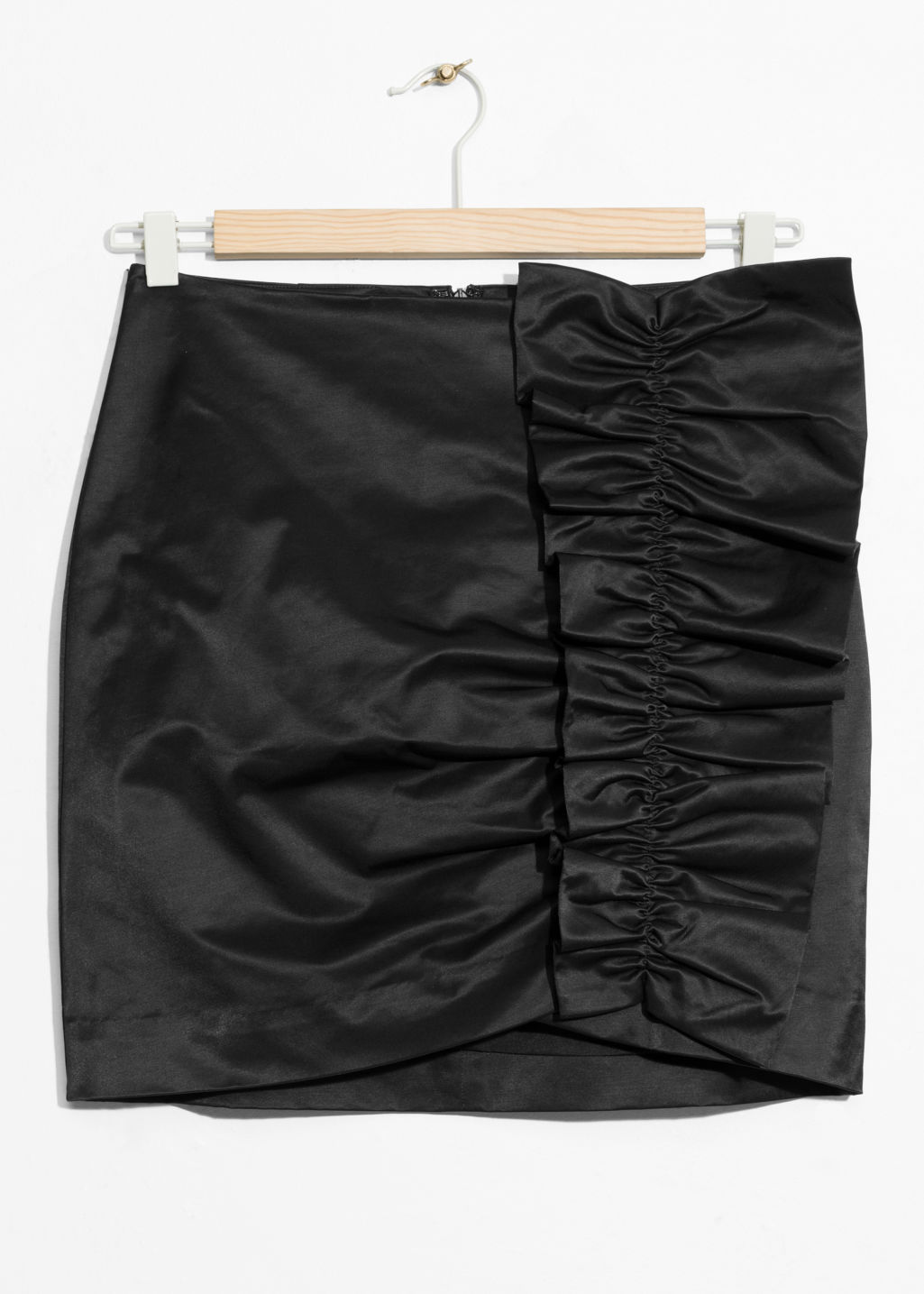 Front image of Stories ruffle mini skirt in black