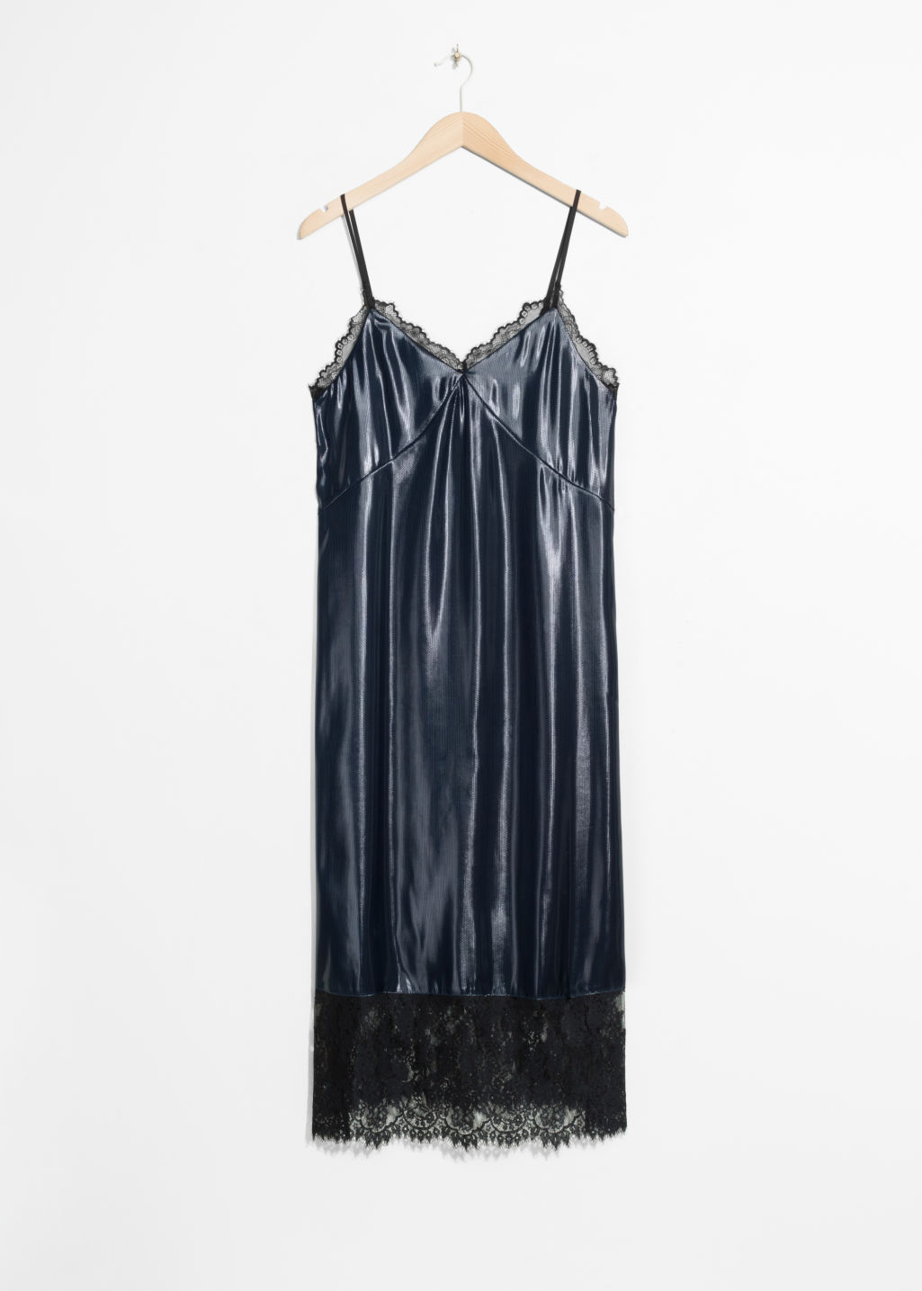 Front image of Stories lamé slip dress in blue