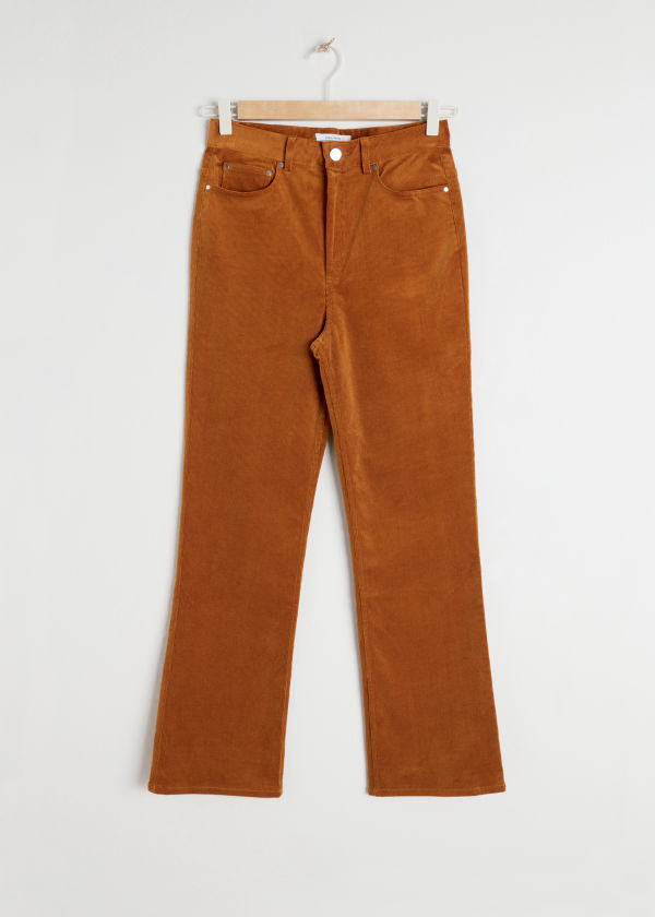 Front image of Stories kick flare corduroy trousers in orange