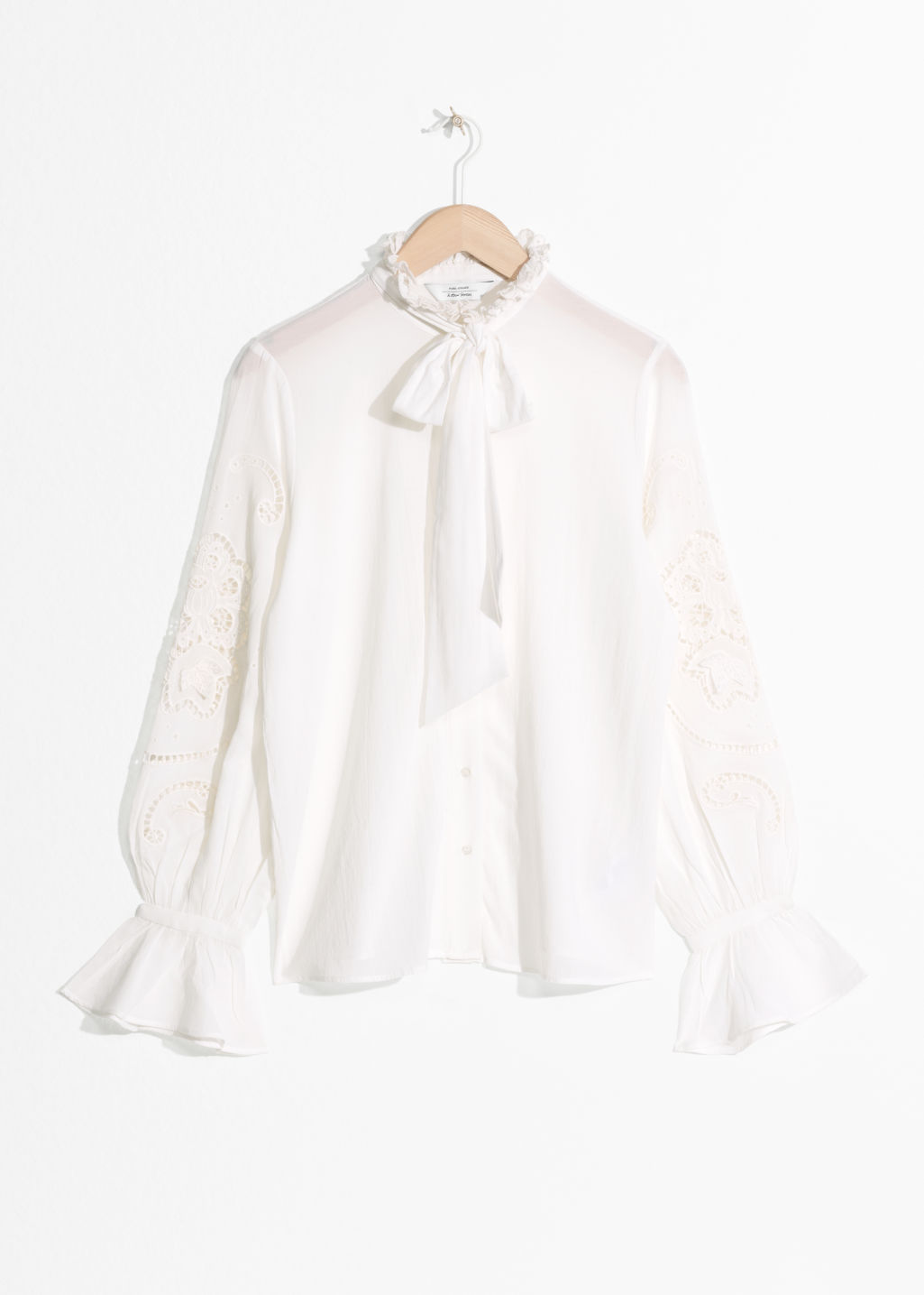 Front image of Stories tie detail blouse in white