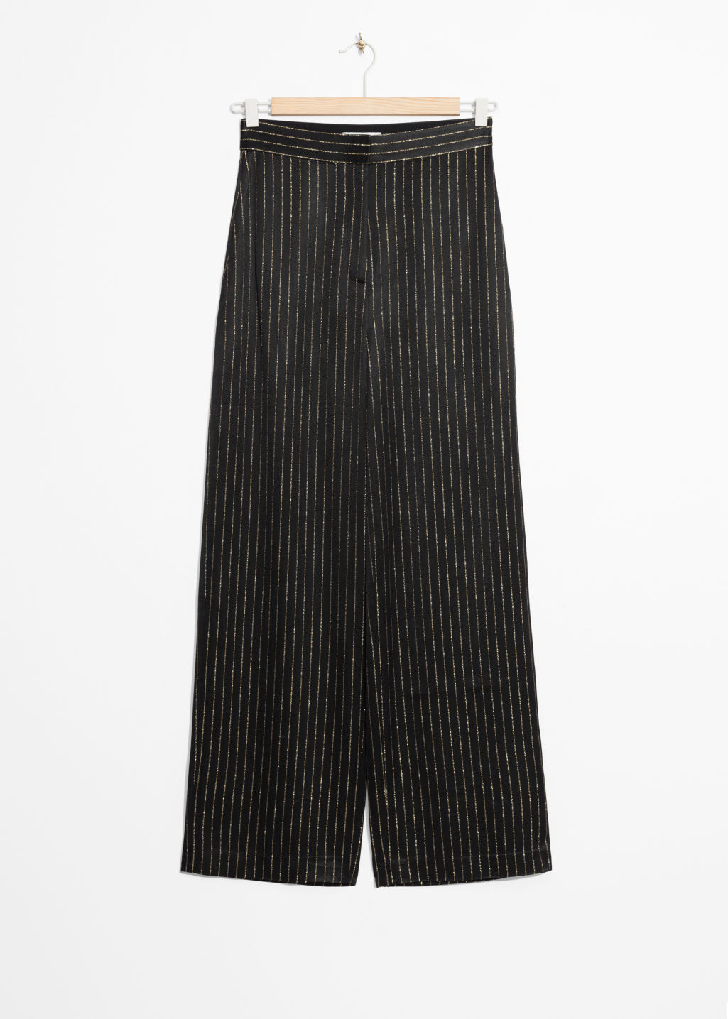 Front image of Stories gold-tone pinstripe trousers in black