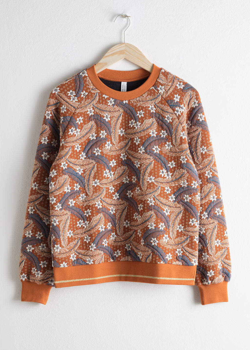 Front image of Stories vintage floral sweater in orange