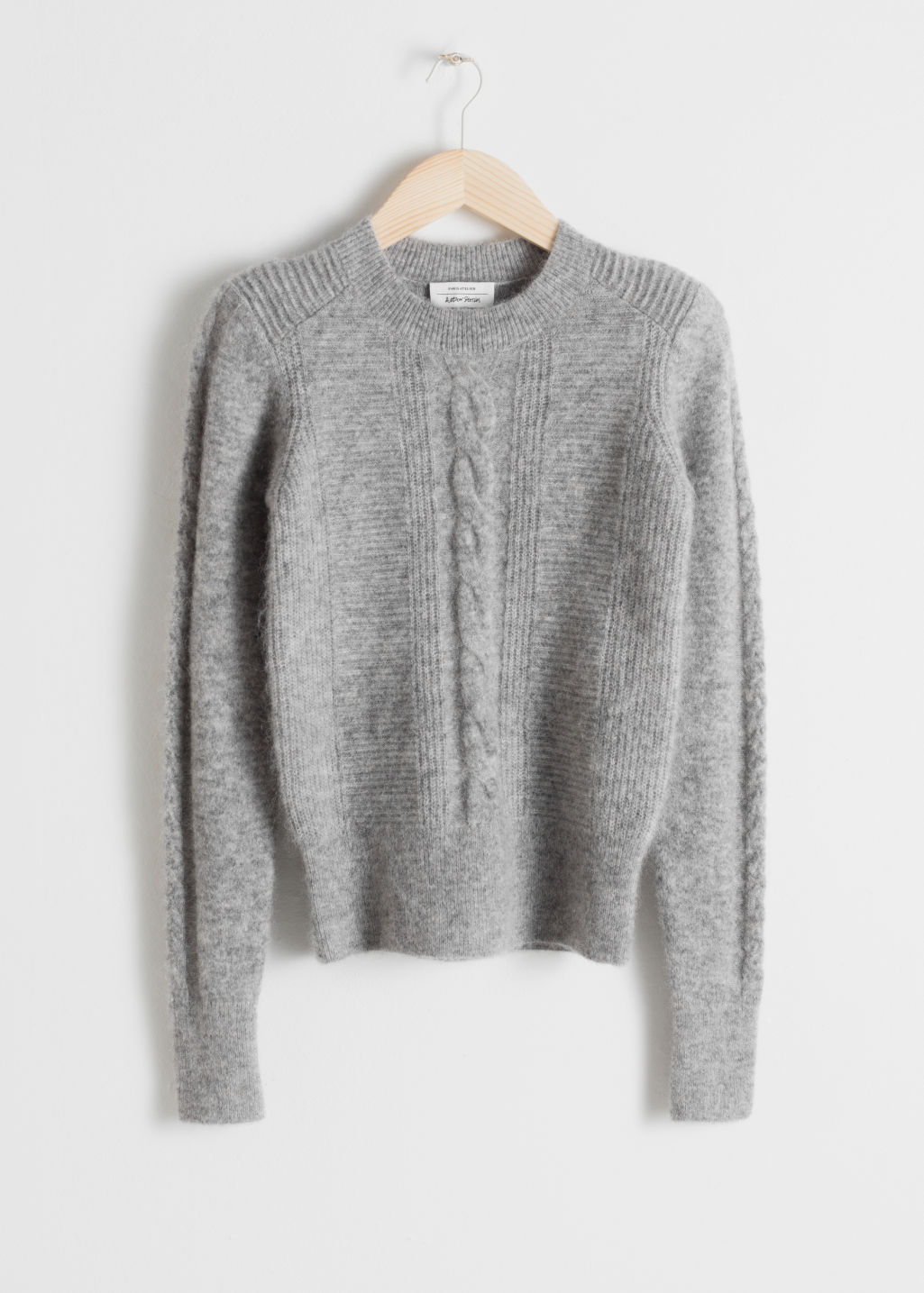 Front image of Stories cable knit sweater in grey