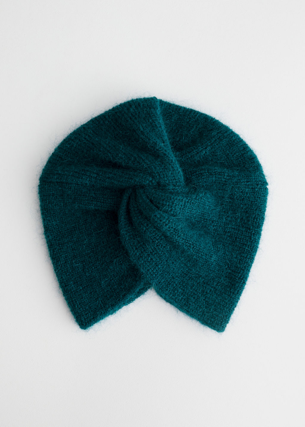 Front image of Stories twist beanie in mohair blend in turquoise