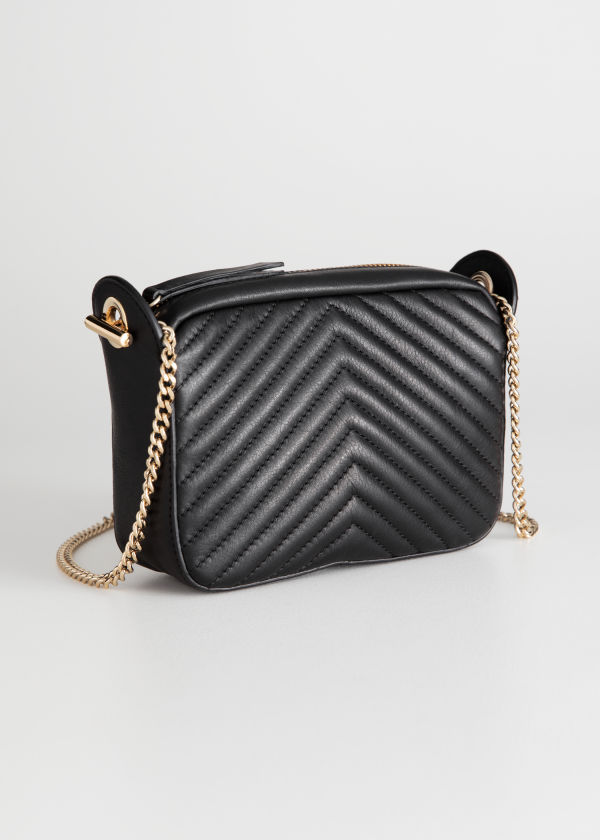 Front image of Stories quilted mini bag in black