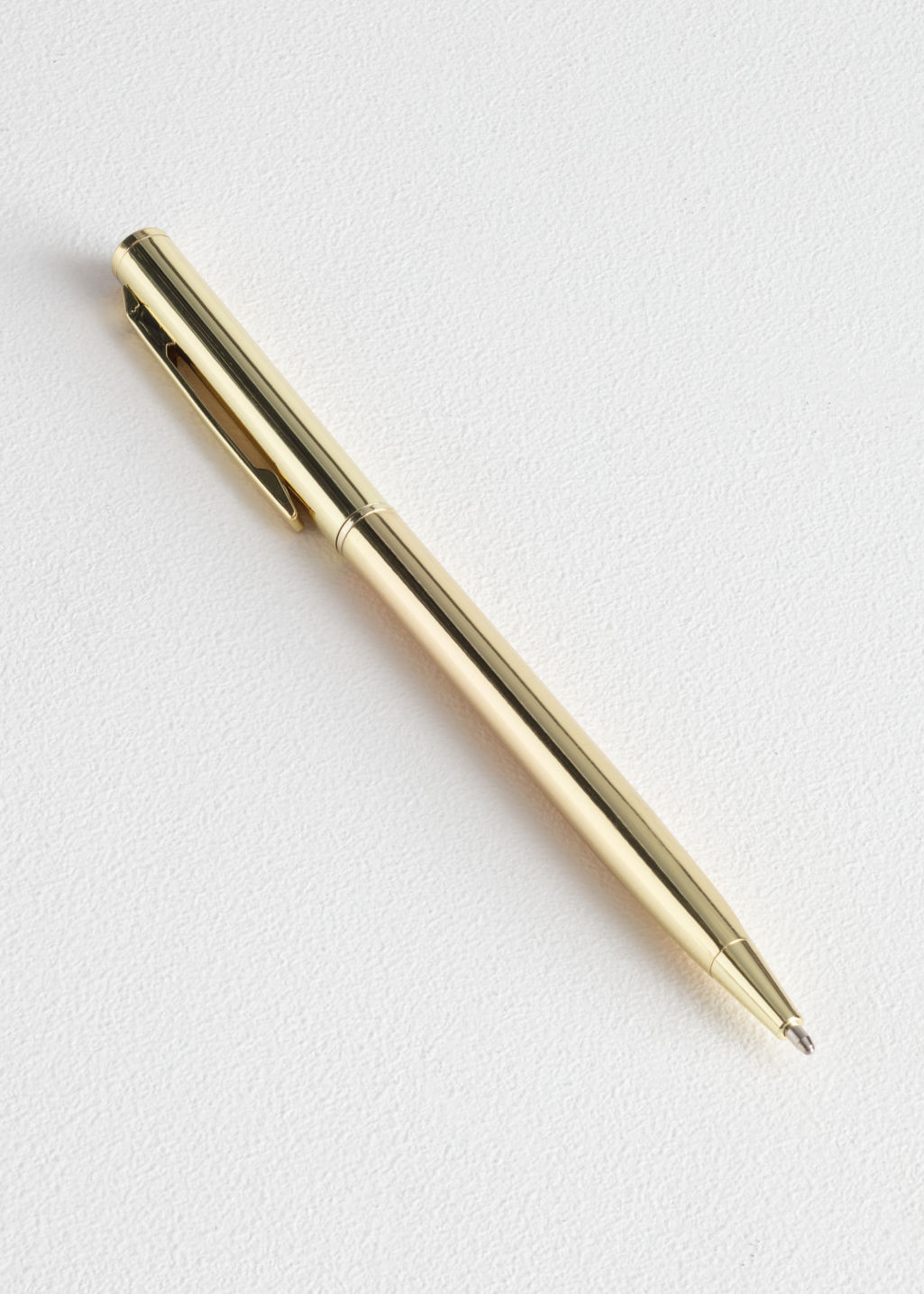 Front image of Stories brass ballpoint pen in gold