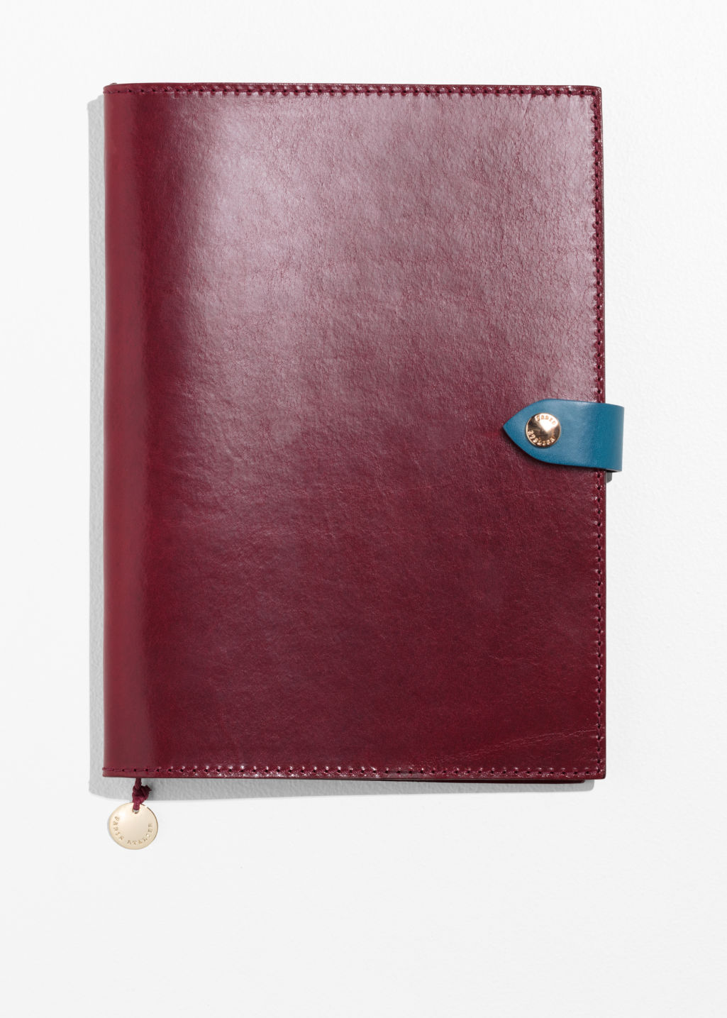 Front image of Stories leather a5 notebook cover in red