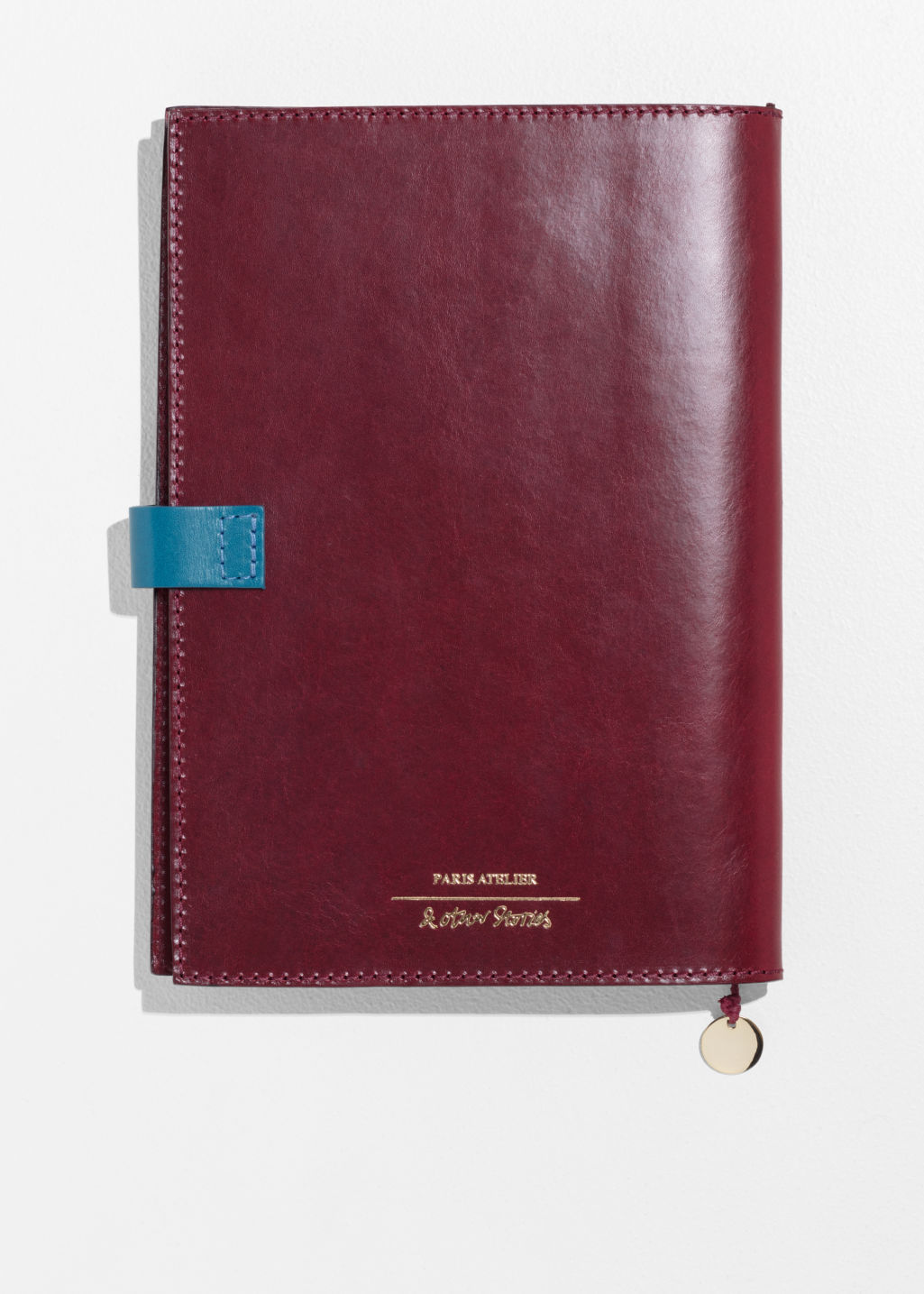 Back image of Stories leather a5 notebook cover in red
