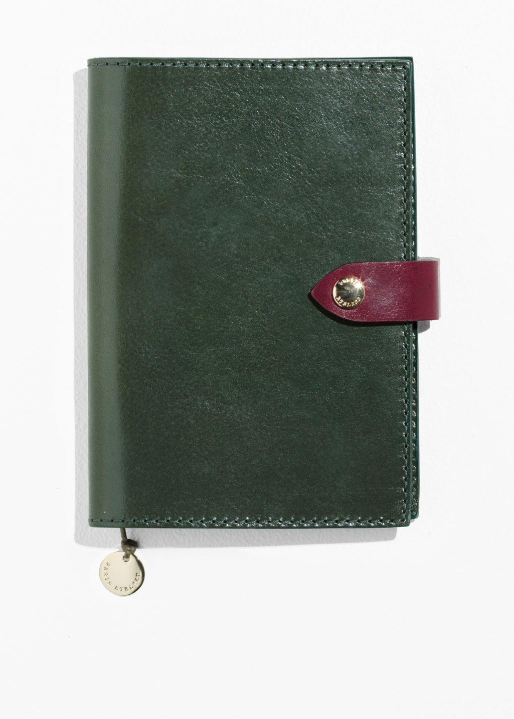 Front image of Stories leather a6 notebook cover in green