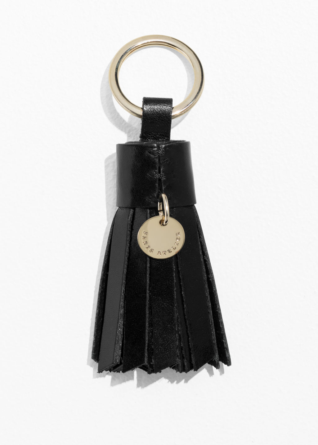 Front image of Stories leather tassel keyring in black