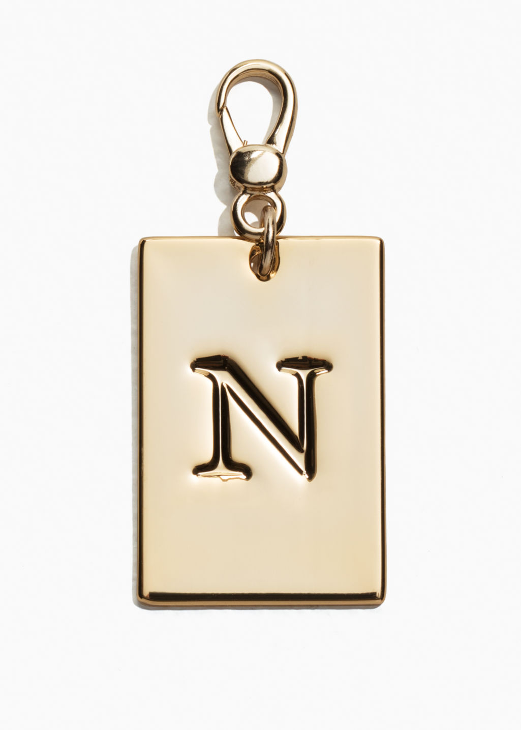 Front image of Stories letters keyring in gold