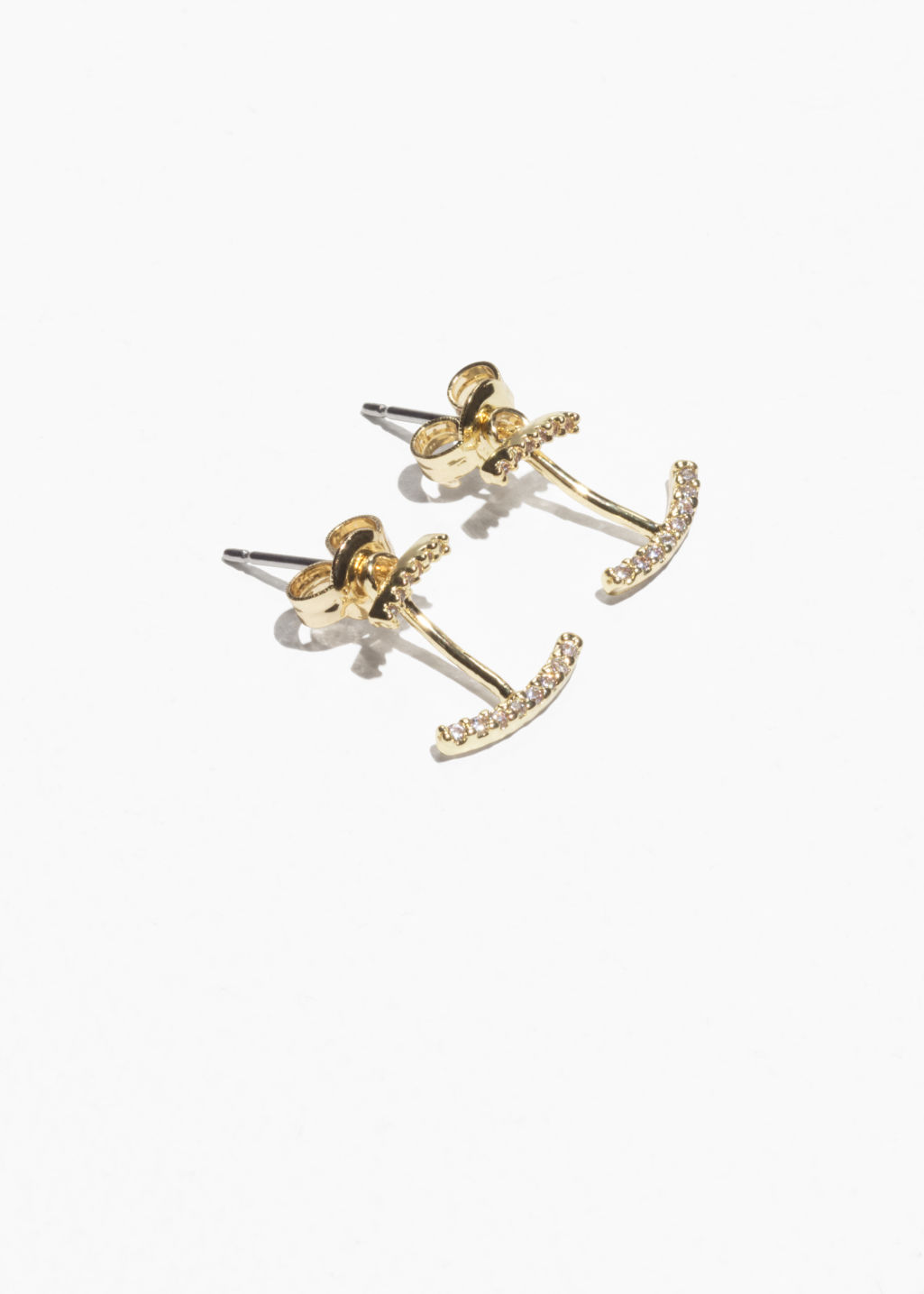 Front image of Stories jewel encrusted ear jacket studs in gold