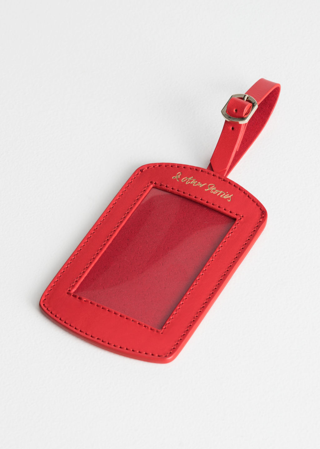 Front image of Stories leather luggage tag in red