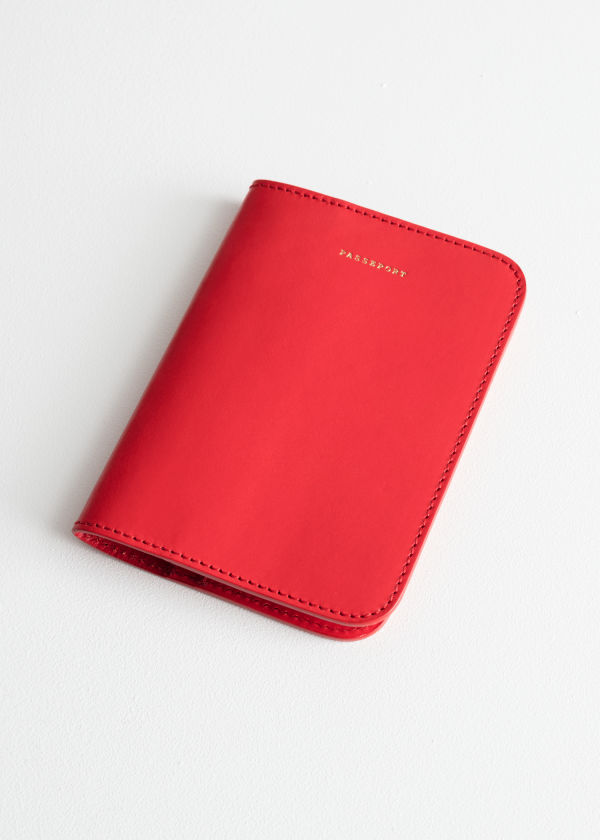 Front image of Stories leather passport holder  in red