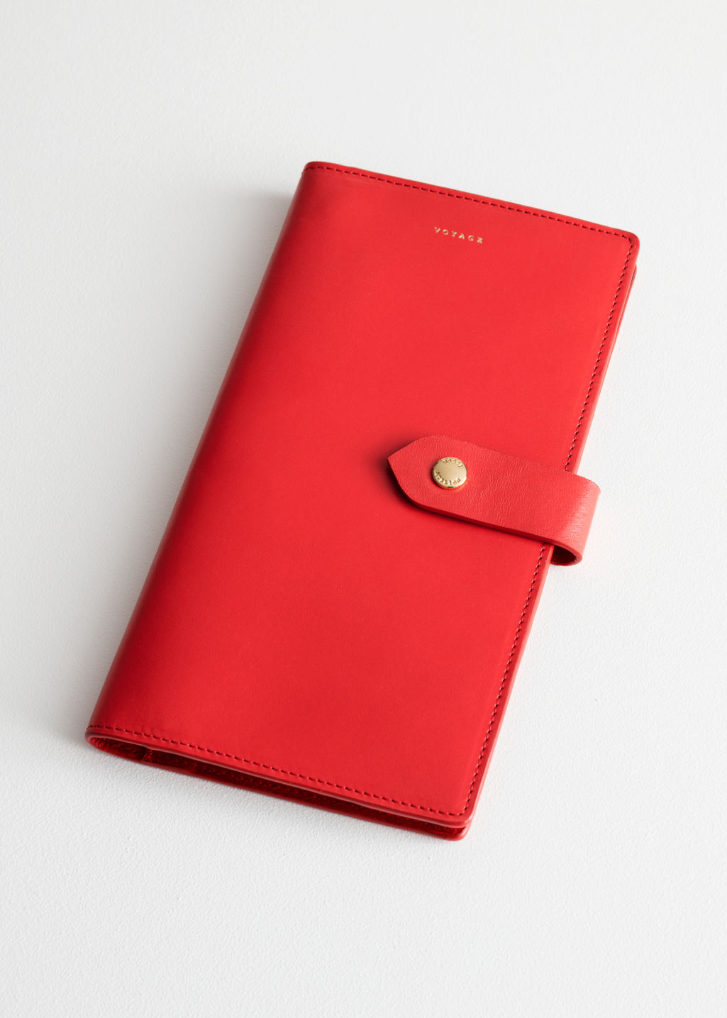 Front image of Stories leather travel wallet in red