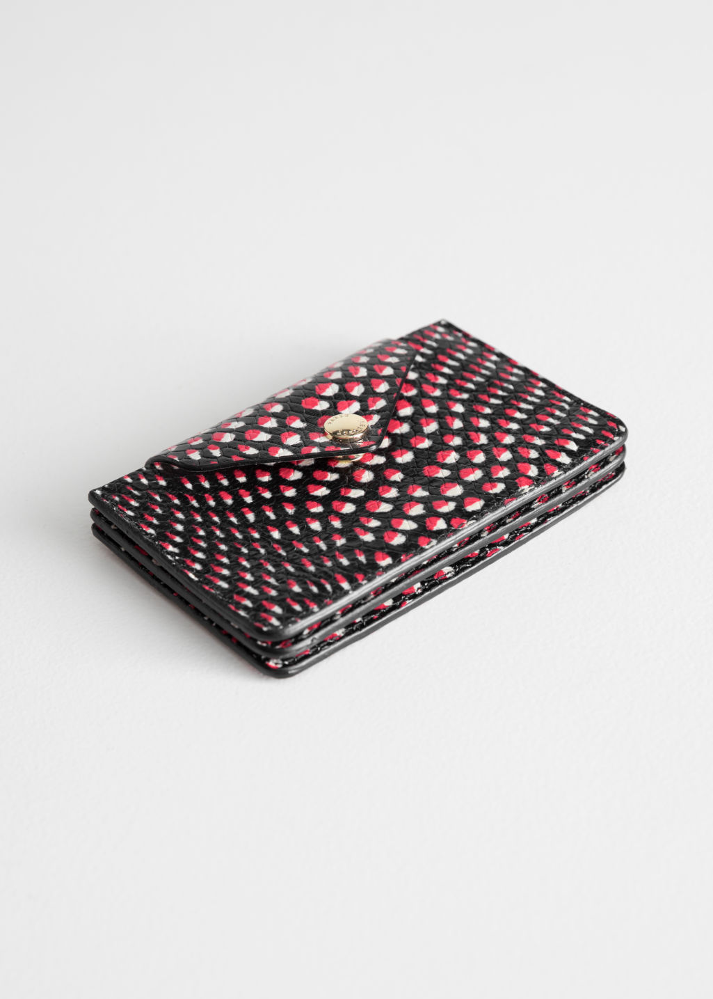 Front image of Stories p paulette card holder in red