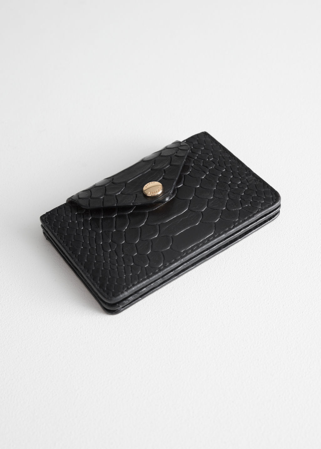 Front image of Stories leather card holder in black