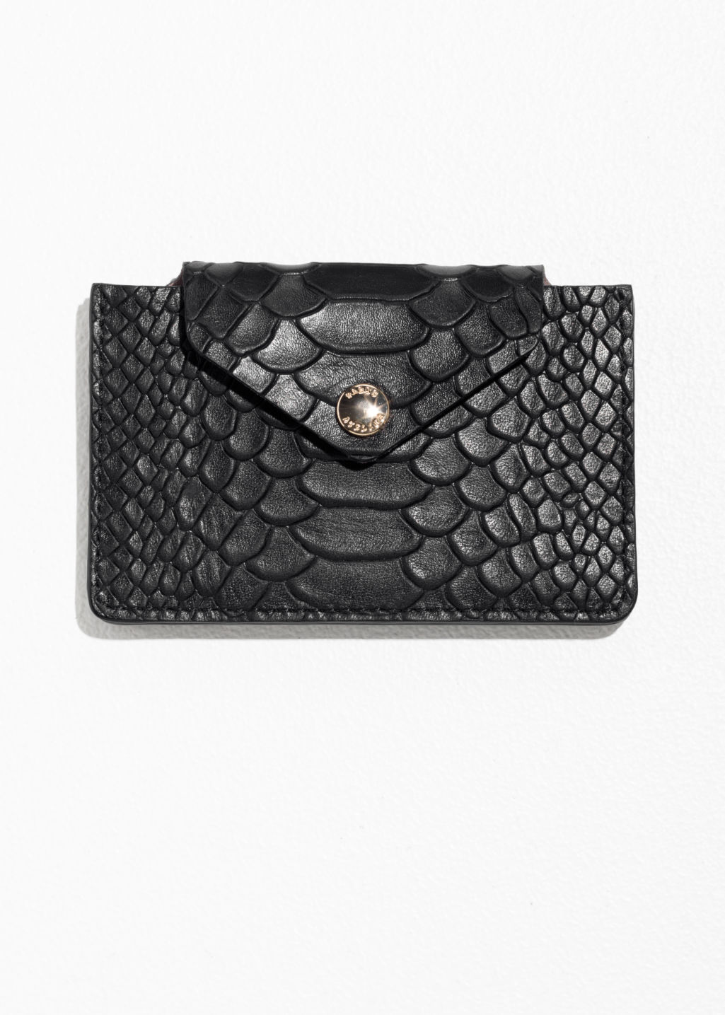 Front image of Stories p paulette card holder in black