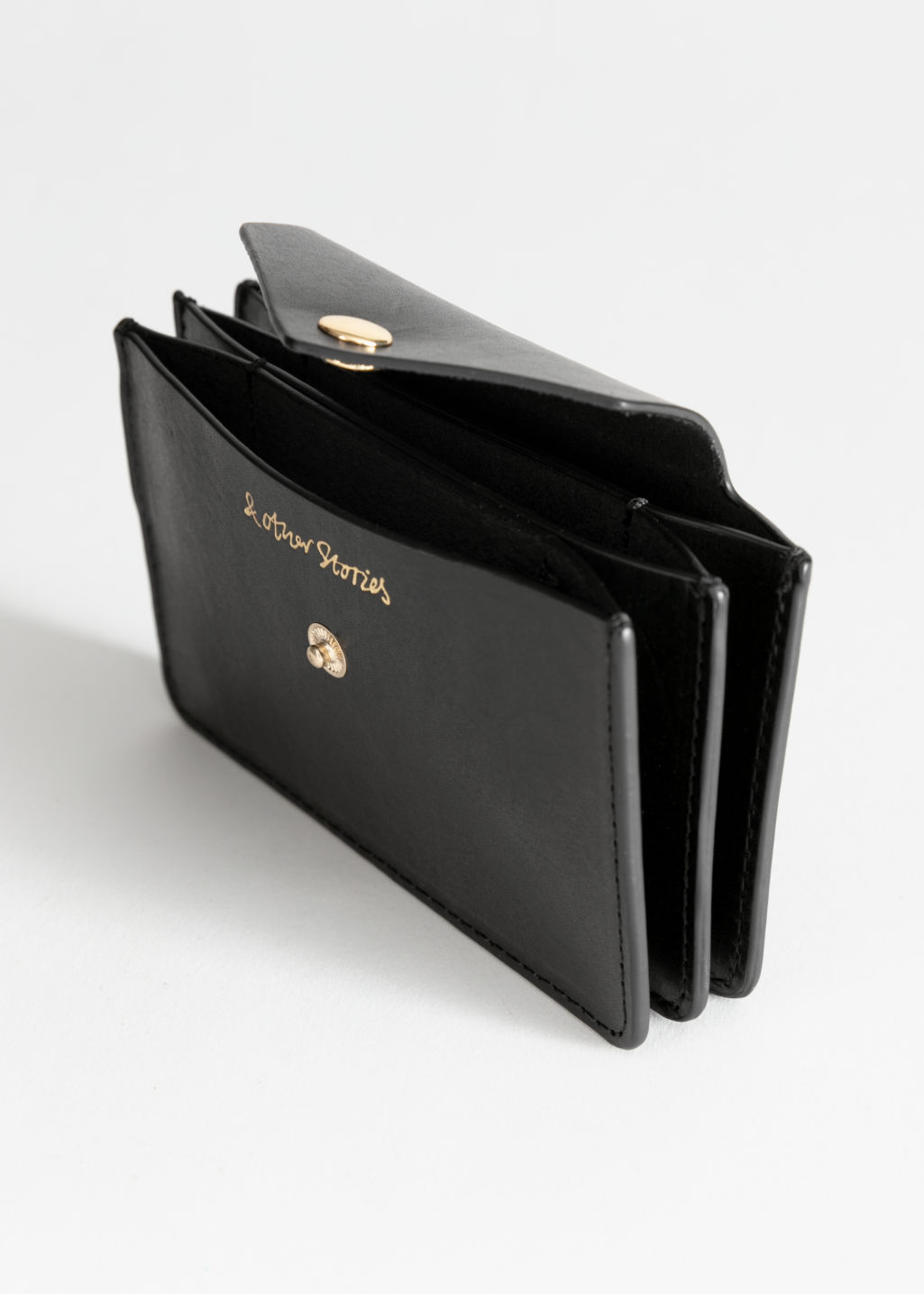 Back image of Stories leather card holder in black